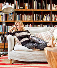 Photo: Sitting pretty: Crow in her NYC loft, with wall-to-wall draper's cabinets (used as bookshelves) from the Sundance catalog, a rug from Pottery Barn, and a table and couch from ABC Carpet & Home. (Crow wears sweater and pants by Isabel Marant; visit isabelmarant.tm.fr.)