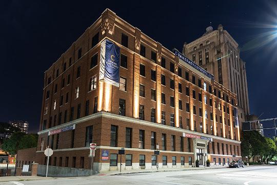 Exterior brick apartment building at night