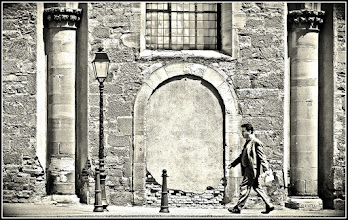 Photo: a man at noon in the old town of Colmar / France