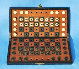 Photo: Image of a TRM set - see: http://dorland-chess.com/236-de-la-rue-stud.html  This is a leather-board version - with 36 capture/reserve holes - and, interestingly, a clearly-original set of matching draughts/checkers stud-pieces. This set was sourced from the US. Peter also has a chess/draughts version: http://tinyurl.com/buy5t9b - a linen surface one.   Marco also has another TRM set (without the additional pieces) that was acquired from the UK, however.  Jon also has a TRM leather-board set identical to these (without draughts pieces) - again sourced from the US.