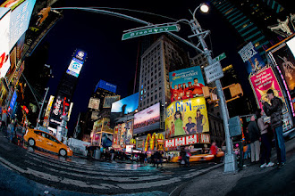 Photo: Here's a shot of Times Square in New York City that's hot off the presses. I took this shot a couple of hours ago and just finished up the processing. I'm in town for a couple of days to see my son's hight school band and jazz band play a couple of concerts, the biggest one being at Carnegie Hall tomorrow night. Earlier tonight the entire crew was herded down to Times Square for a quick group photo and then it was off to see Spiderman. I'm not officially attached to the tour so I didn't get tickets, so instead I spent some time wandering around Times Square taking pictures. For some reason I find the fisheye works well in this space. Perhaps the funky nature of the lens compliments the bright lights and big signage of the area. Anyway, I hope you enjoy it.