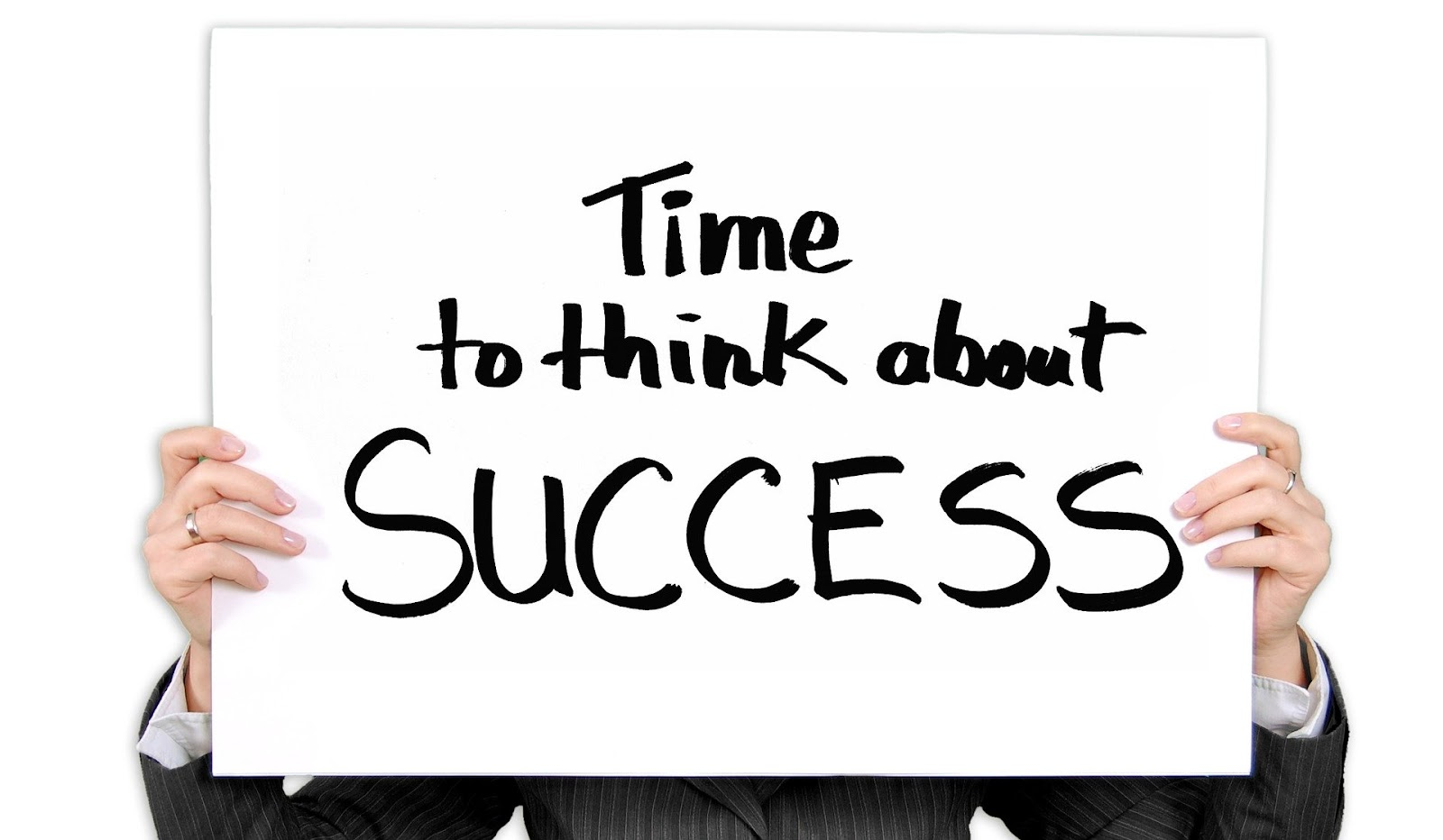 Sign displaying that its time to think about success