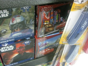 Photo: My son loves puzzles, so we had to check out the selection for our stocking on the way.