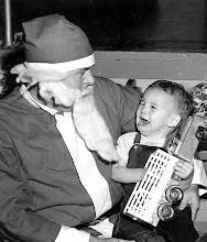 Photo: Joseph Purves, age 1 1/2, son of Lawrence Purves, QM1 shows his momentary unhappiness at the Chase Christmas party on Dec 22, 1958