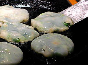Photo: pan-frying steamed stuffed chive cakes