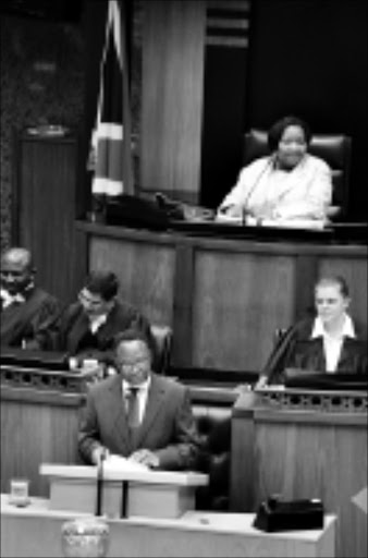 CENTRE STAGE: South African President Kgalema Motlanthe responds to parliamentary questions after the debate on his speech. He also announced the election date as set for April 22. 10/02/09. Pic. Elmond Jiyane. © Unknown.