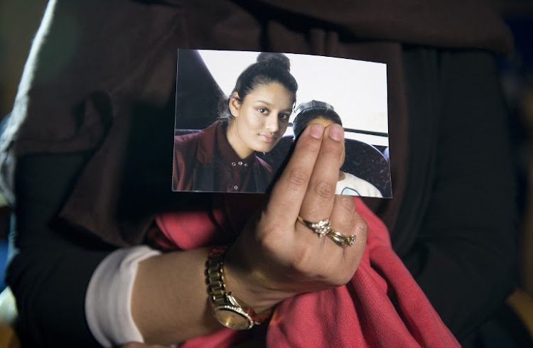 In this file photo taken on February 22 2015 Renu Begum, eldest sister of British girl Shamima Begum, holds a picture of her sister. Shamima, who fled to join the Islamic State in Syria, wants to return home but the UK has decided to revoke her citizenship.