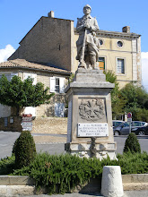 Photo: Gordes' war memorial, an ever-present scene in most every French town, no matter how small. As usual, it was built to honor the WWI fallen, with names later added for WWII, and often the Algerian War (1954-1962) as well.