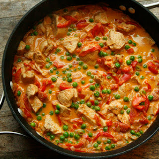 Creamy Tomato Shallot Chicken Skillet with Red Peppers and Peas.