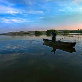 Fisherman  at lagoon by Cristobal Garciaferro Rubio - People Portraits of Men ( clouds, sky, lagoon, wagter, trees, lake, boat, fisherman )