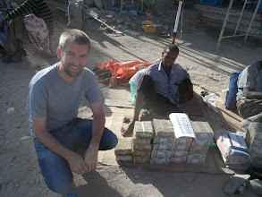 Photo: Moneychangers in downtown Hargeisa sit outside with stacks and stacks of cash