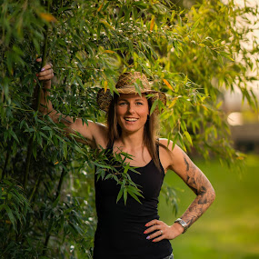 in the jungle  by Michel Vandermeersch - People Portraits of Women ( tattoo, green, safari, sleeve, hat, jungle, girl, eyes,  )