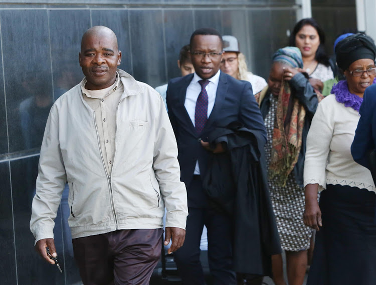 Baby Siwaphiwe's mother, Sibongile Mbambo, follows her husband, Christopher Mbambo, and attorney Mfanafuthi Biyela out of the Durban Magistrate's Court.
