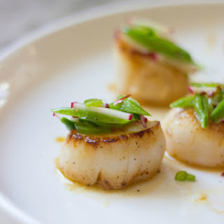 Orange-Ginger Seared Scallops + Sugar Snap Pea Slaw.