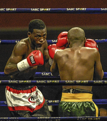 Sabelo Ngebinyana, left, is the new WBA Pan African junior bantamweight champion after ending Sikho Nqothole's winning streak in Swaziland on Friday.