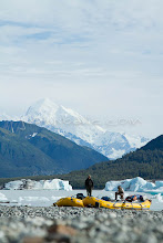 """Photo: Loading boats on Alsek Lake while on a  raft trip down the Tashenshini River. The """"Tat"""" flows out of Yukon, CA, through British Columbia and empties into Glacier Bay National Park in Alaska, US."""