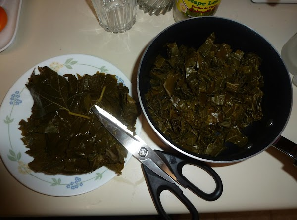 Take the grape leaves out of the jar and unroll them.Bring 6 cups of...