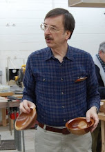 Photo: Gary Guenther with a pair of cherry bowls from the same log illustrating John Jordan's point about the effects of aging on the sapwood contrast.