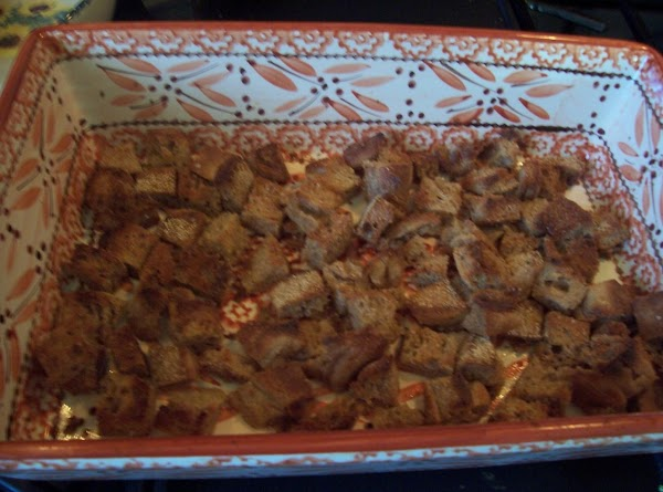 Cube approximately 2C. day old (stale) bread and place in casserole dish. (I used...