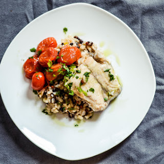 Poached Barramundi With Burst Tomatoes On Wild Rice Pilaf