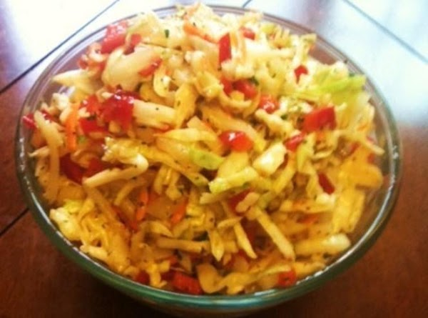 Chop the Red bell pepper,and sweet onion. Pour the bag of Cole slaw in...