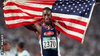 Michael Johnson holding the US flag