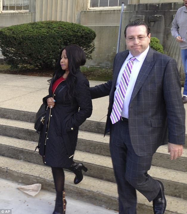 Crestfallen mom: A somber-looking Carol is escorted from the Nassau County courthouse by her son's attorney, David Schwartz