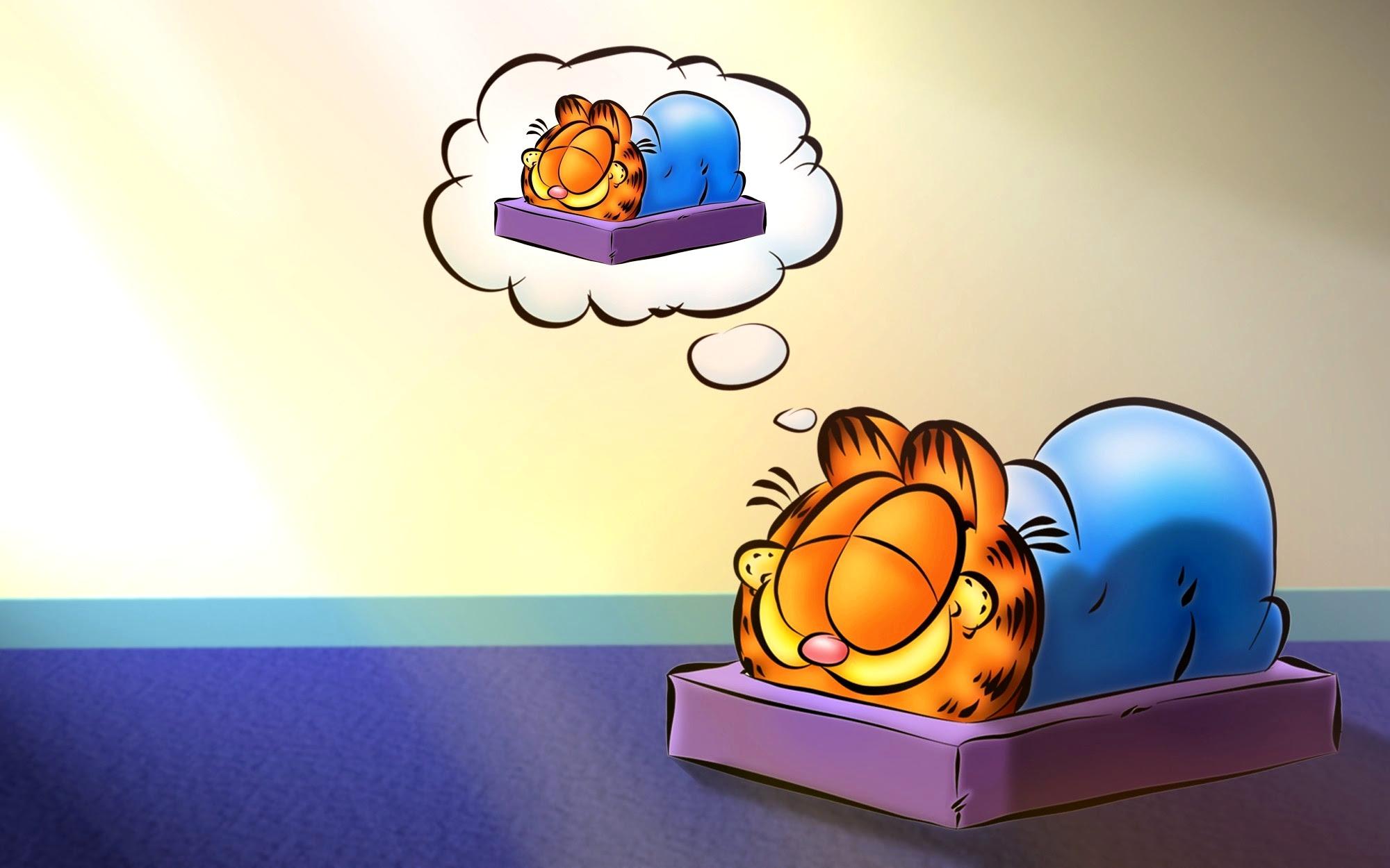 ILUSTRAÇÃO: Garfield dormindo, com um balão de um sonho onde ele está também dormido