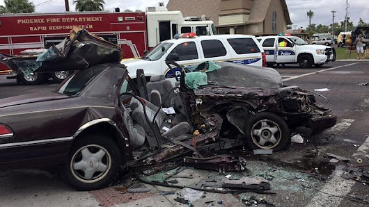 Woman dies, man hurt in collision at Phoenix intersection