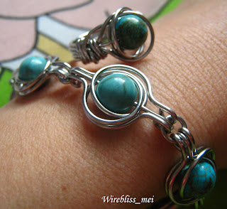 twice around the world (TAW) wire wrap bracelet and ring on wrist and finger