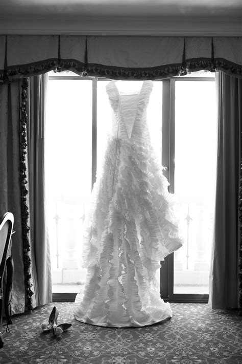 hanging wedding dress photo by @nicole hill gerulat #