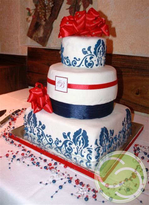 Red, white and blue wedding cake. Square and round tiers