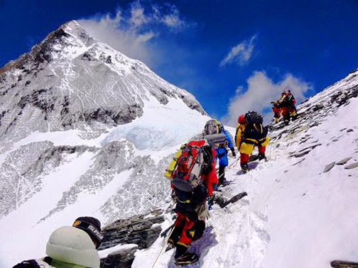 [Photo of climbers climbing Mt. Everest]