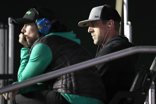 Aaron Rodgers watches Daytona qualifying race from Danica Patrick's pit box