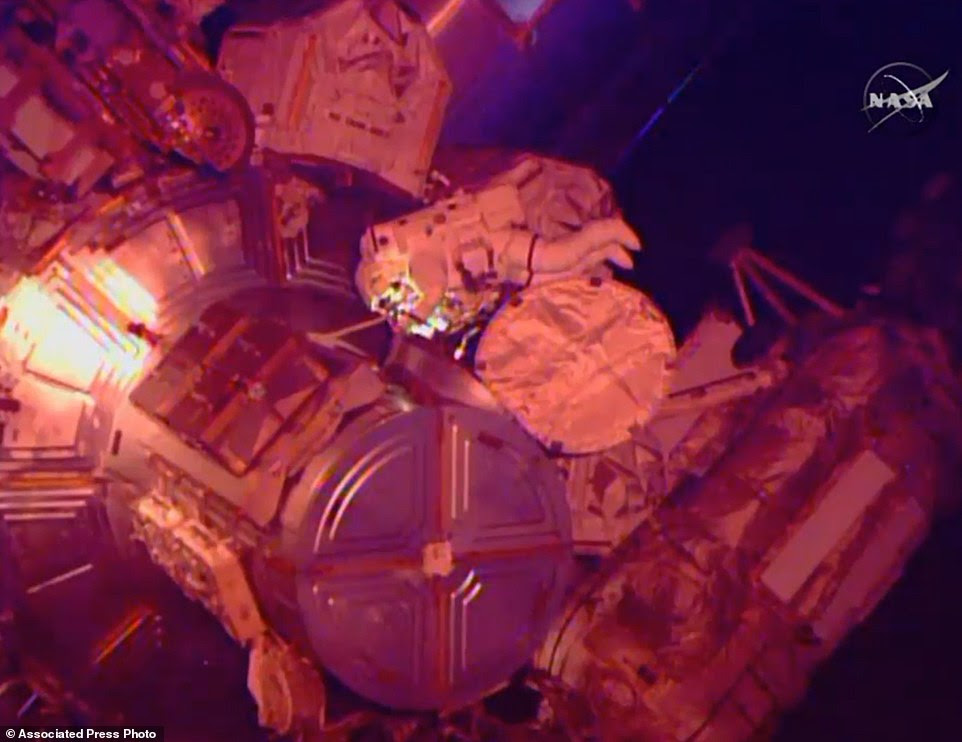 In this image from Nasa television astronaut Terry Virts exits the Quest airlock hatch beginning the third spacewalk outside the International Space Station early Sunday morning March 1, 2015