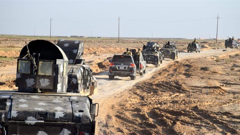 Iraqi military trucks advance into an area in eastern Ramadi city on December 2 [EPA]