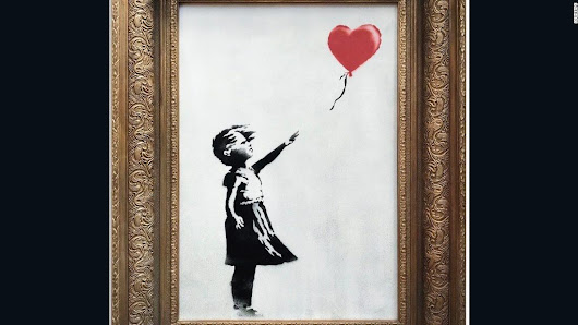 Banksy painting 'self-destructs' moments after being sold for $1.4 million