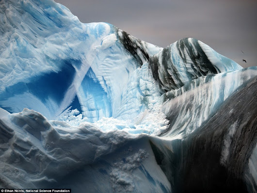Stunning new images reveal the UNDERNEATH of an iceberg