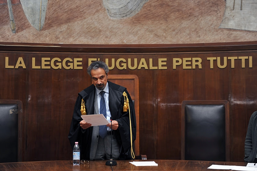A November 2009 photo from Milan shows Italian judge Oscar Maggi reading the verdict against Robert Lady and other CIA officials. (GIUSEPPE CACACE/AFP/Getty Images)