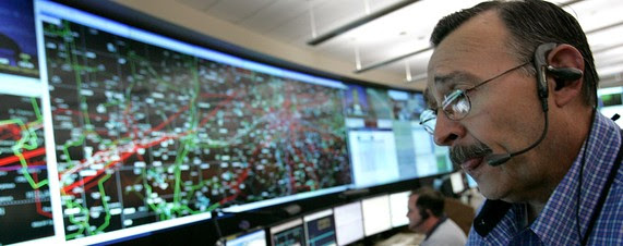 [Robert Moran monitors an electric grid in Dallas. Such infrastructure grids across the country are vulnerable to cyberattacks.]