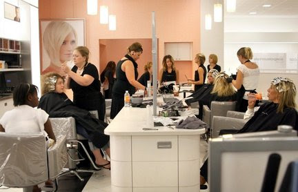 Ulta Beauty work on their clients at the store's newest location in
