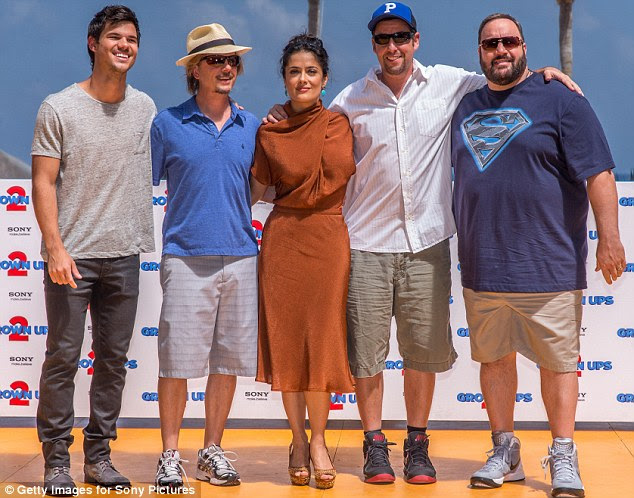 While Salma was the picture of Hollywood movie star, her funnymen costars wore laid-back T-shirts, shorts and jeans