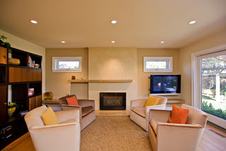 living room with travertine fireplace modern family room