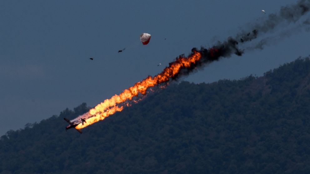 PHOTO: Two planes with an Indonesian aerobatics team collided while practicing for an airshow in Malaysia on March 15 2015.