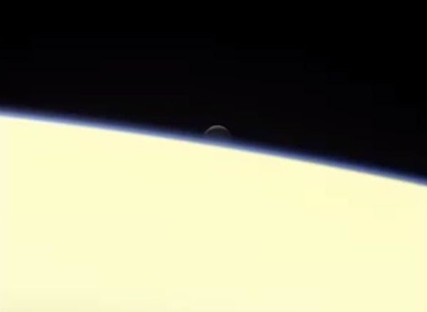 An image of the ocean-bearing moon Enceladus disappearing behind Saturn...as seen by NASA's Cassini spacecraft on September 13, 2017.