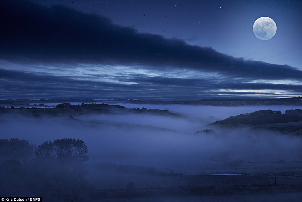 Beautiful darkness: Moonlit valleys in Compton Valence, Dorset. When most people stay indoors weather nut Kris spends hours out and about waiting for the rain to clear or a break in the clouds to get the perfect shot