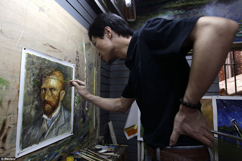 Painter Zhao Xiaoyong works on a copy of a self-portrait by Van Gogh in his gallery: Artists here manufacture some 60 per cent of the total global volume in such knock-off canvases, according to the China Daily