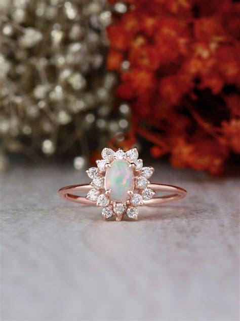 Oval Opal and Celestial Diamond Halo Solid 14 Karat Gold