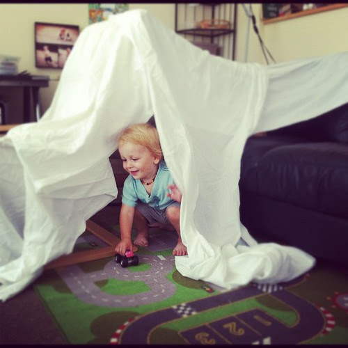 What to do with the fabric from your togas after the party's done? Build a fort for your kids!  =P