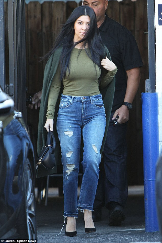 She's ripped: Kourtney's jeans were stylishly torn and tattered as she left the buidling
